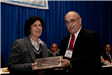 Mayor Janice Mironov accepts Public Information Award from RU's Ray Caprio