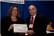 Middletown's Cindy Herrschaft presented a Public Information Award by RU's Ray Caprio