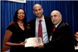 Public Info Award Winner Desiree Peterkin Bell with Mayor Cory Booker  and RU Prof. Ray Caprio