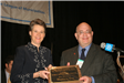 Woodbury City's representative accepts a Municipal Public Information Contest award
