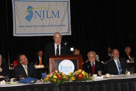William Faherty, accepts the 6th Annual Outstanding Public Servant Award speaks as Exec. Dir. Dressel, NJLM Pres. Bowser, and Gov. Corzine listen