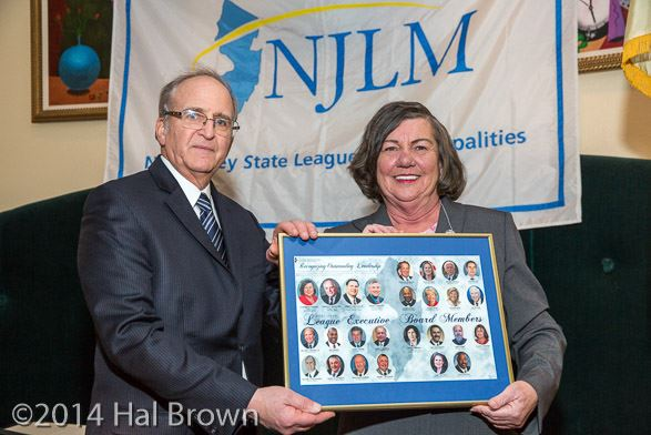 NJLM Executive Director Bill Dressel presents President Suzanne Walters with a commemorative picture of 2014 League Board