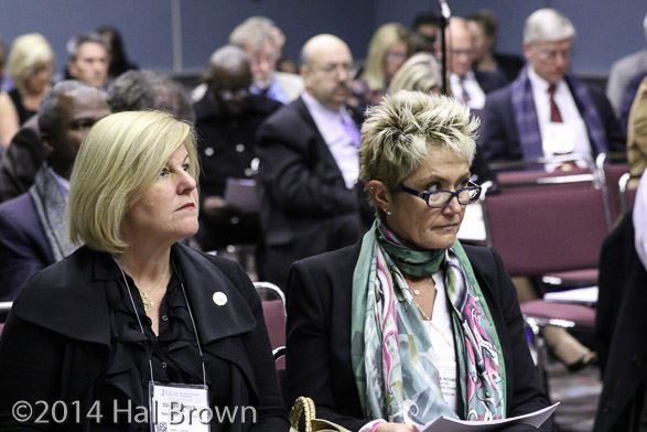 Mayors Colleen Mahr and Janice Kovach listen intently at the League Resolution Committee meeting