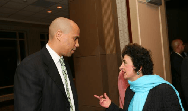Newark Mayor Cory Booker visits with League Past President and Princeton Mayor Phyllis Marchand