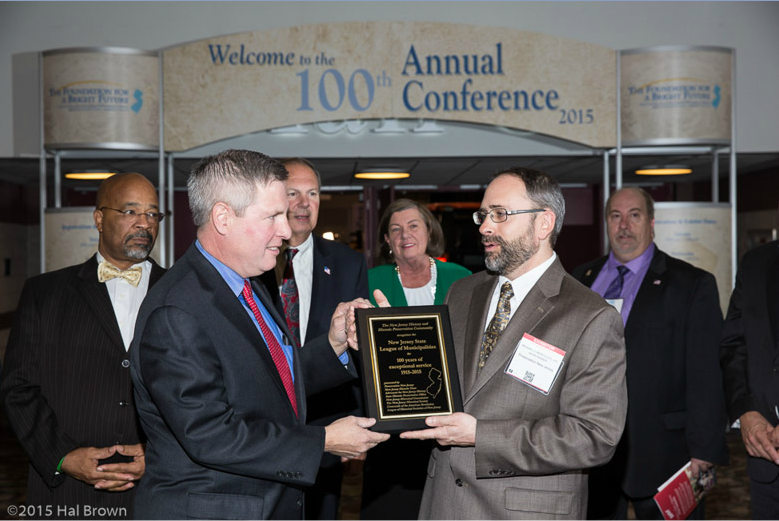 Mayor Brian Wahler accepts a plaque for the League's 100 years of service from Michael Margulies of Preservation NJ