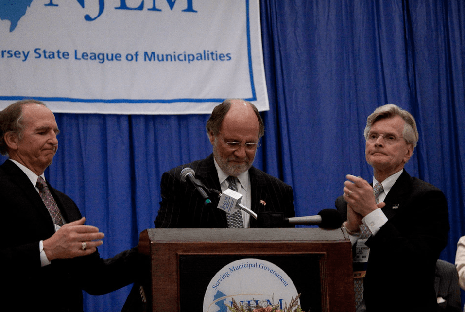 NJLM's William Dressel (l) and President Tim McDonough flank Gov. Jon Corzine as he speaks at League Luncheon