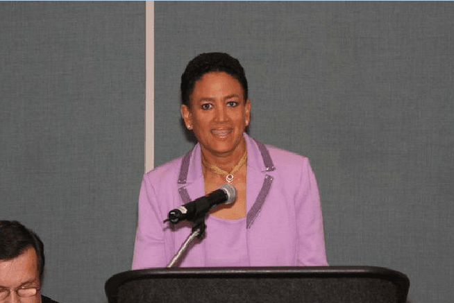 Secretary of State Nina Wells addresses the Women in Government Breakfast