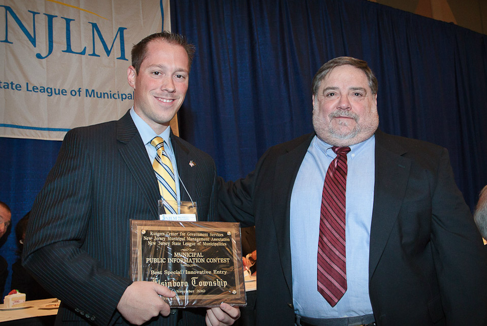 Elsinboro Twp's Sean Elwell accepts the Municipal Public Information contest plaque from RU's Zalkind (r)