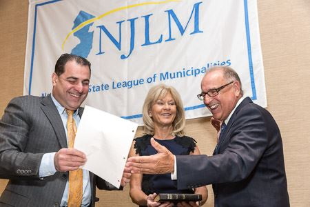 NJLM President James Cassella (r) sworn in with wife Janice by NJ Sen. Paul Sarlo